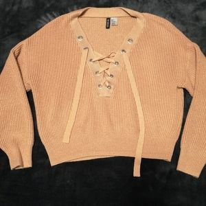 Cropped pink divided sweater